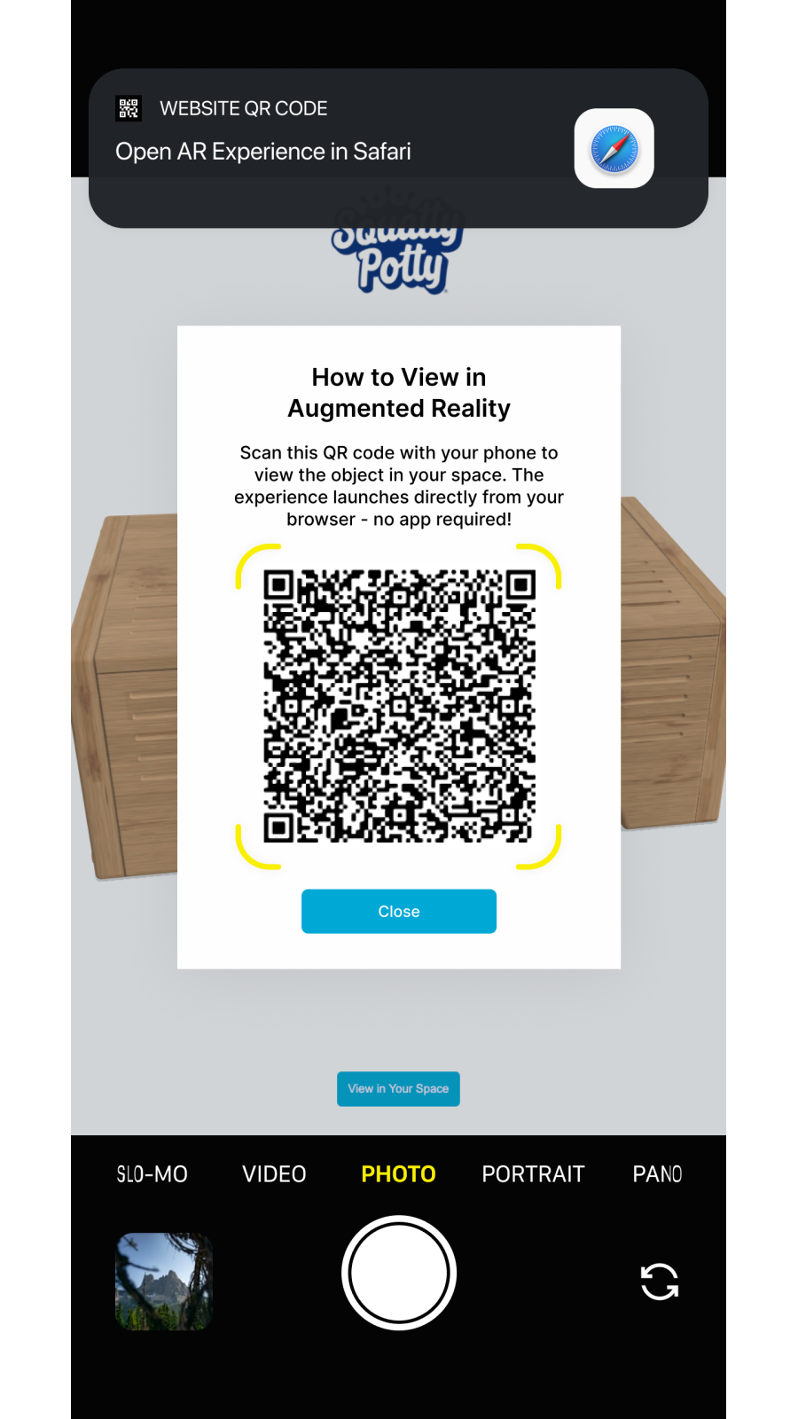 Scan the QR code with a phone camera to launch AR
