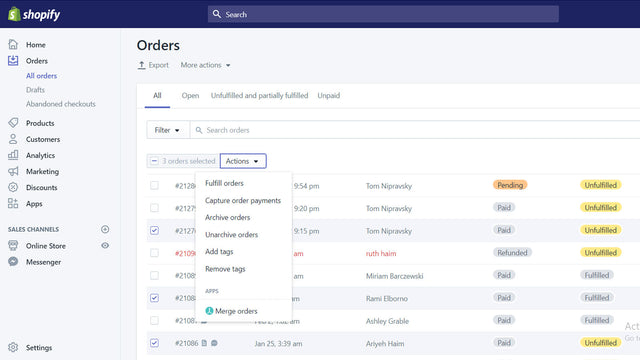 Manually select orders to merge from the orders page.