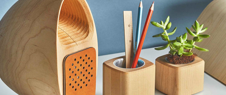 Wooden speaker, wooden stationary holder with a ruler and pencils, and a wooden planter