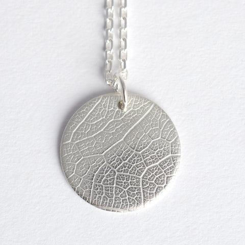 Textured medallion necklace