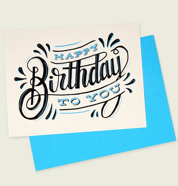 Greeting Card by Fifty Five Hi's with Happy Birthday to you Text in Blue on Teal Card Paper 14pt Showing Card Front - Tees.ca
