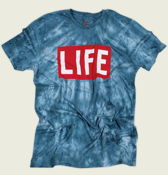 Men T-shirt by Altru Apparel in Blue Tie Dye with Red LIFE Magazine Logo Screen Printed on Cotton Unisex Graphic Tee Shirt Showing Wrinkled Tshirt - Tees.ca