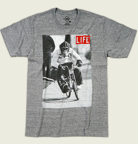 Men T-shirt with Life Magazine Photo with Monkey Riding a Bicycle on Printed Heather Poly Cotton Graphic Tee Shirt Showing Wrinkled Tshirt Front - Tees.ca