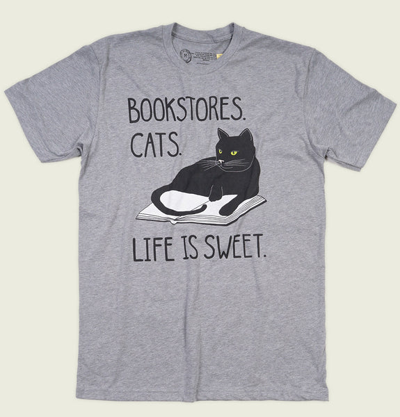 Men T-shirt With Illustration of Cat Laying on Open Book Printed on Heather Gray Graphic Tee Shirt Showing Wrinkled Tshirt Front - Tees.ca