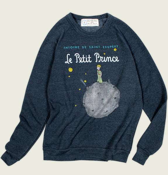 Sweatshirt by Out of Print With Boy Standing on Small Planet Surrounded by Stars and Planets on Navy Fleece Shirt Showing Wrinkled Sweater Front - Tees.ca