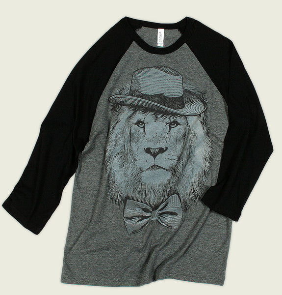 Baseball T-Shirt in Grey Body and Black Sleeves with Screen Printed Lion Portrait Wearing Hat and Bow Tie on Graphic Tee Shirt Showing Wrinkled Tshirt - Tees.ca