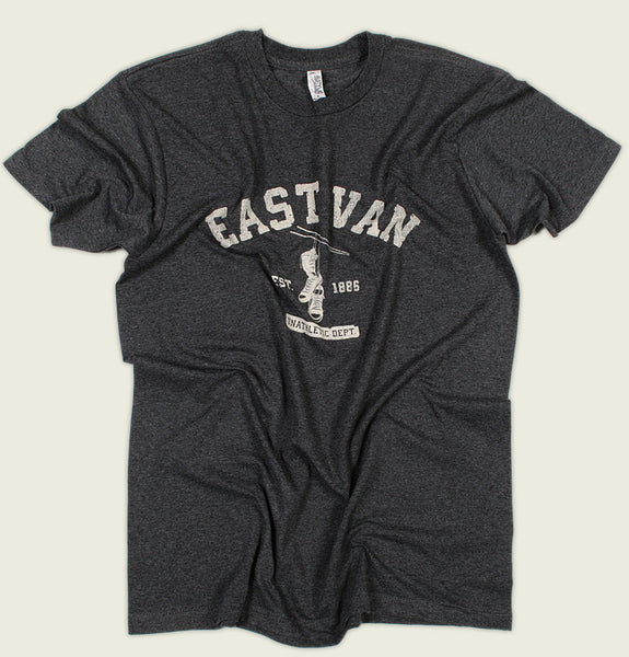 Men T-shirt with Text East Van and Unathletics in White and Shoes Hanging Under Screen Printed on Tri Blend Black Unisex Graphic Tee Showing Wrinkled Tee Shirt - Tees.ca