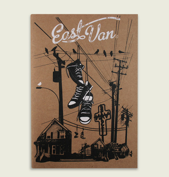 Notebook with Screen Printed EAST VAN White Text and Black Cityscape Details on Brown Cover Showing Front View - Tees.ca