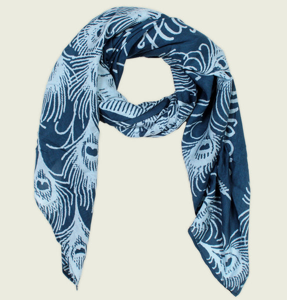 Scarf by Out of Print With Illustration of Peacock Feathers and Text Pride and Prejudice on Blue Cotton Silk Scarf Showing Wrinkled Item - Tees.ca