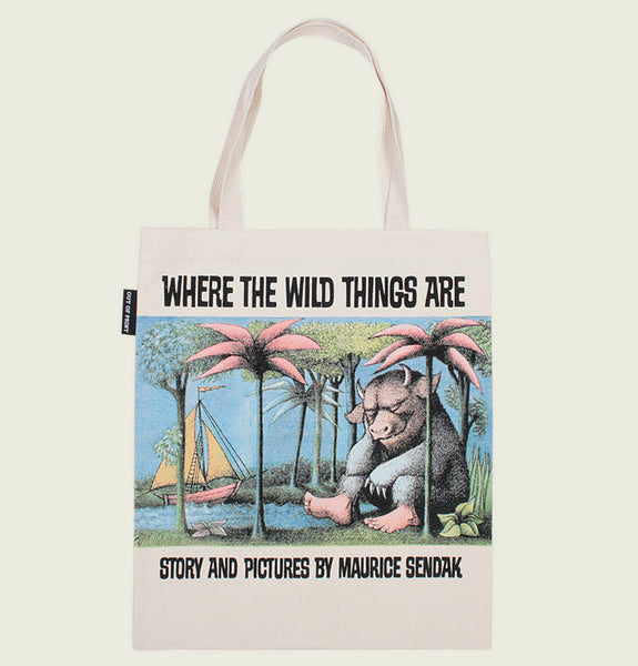 Tote Bag by Out of Print With a Monster Sitting Under the Palms with a Sailing Boat near by on Natural Canvas Tote Showing Bag Front - Tees.ca
