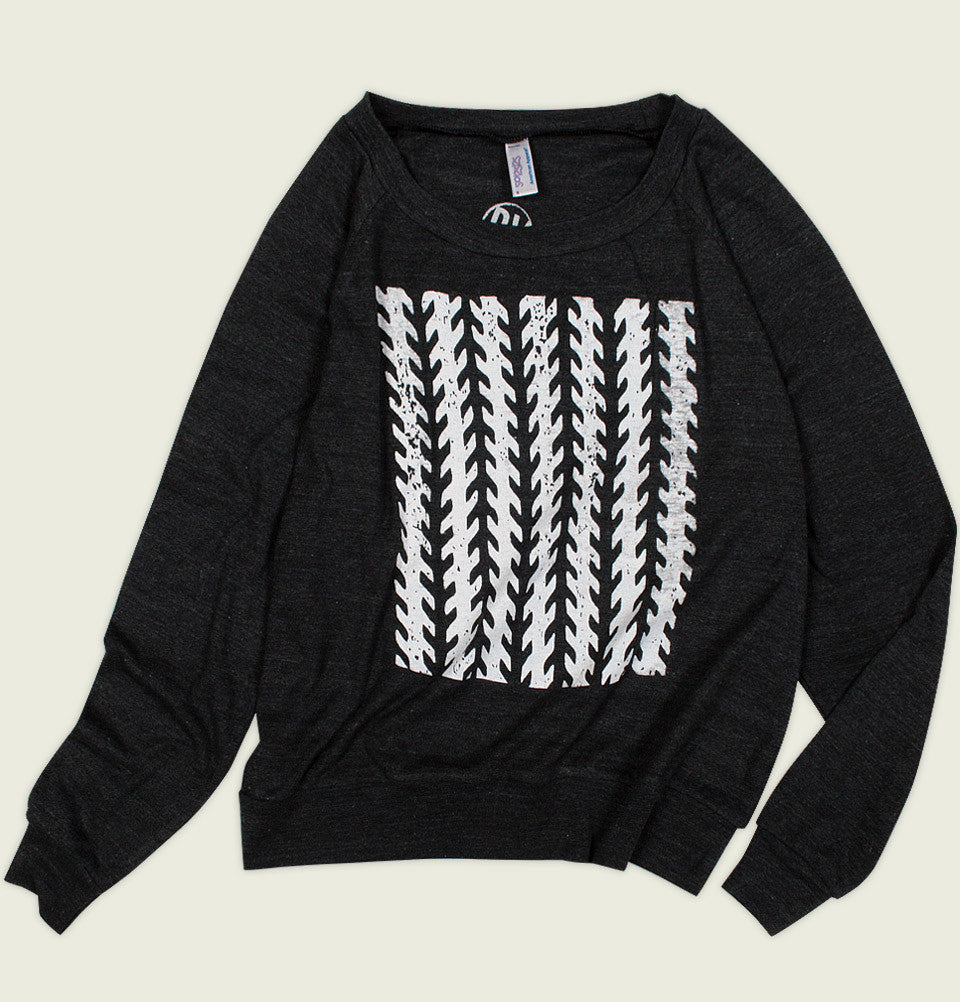 Womens Shirt by Robbie Vergara With Tire Tracks Vertically Printed on Black Long Sleeve Shirt Showing Wrinkled Pullover Front - Tees.ca
