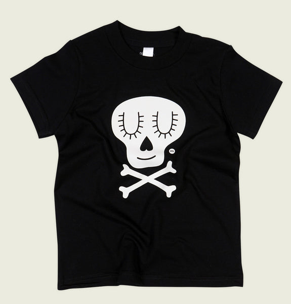 Children Cotton T-shirt With Illustration of Cute Skull and Crossbones Screen Printed on Kids Black Tee Shirt Showing Wrinkled Tshirt Front - Tees.ca