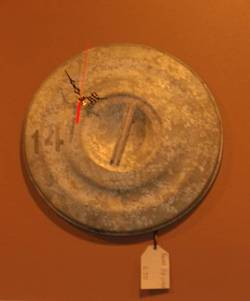 Wall clock made from a dustbin lid
