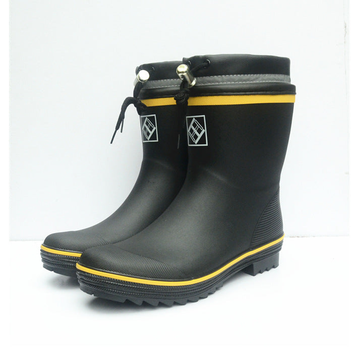 Black toggle wellies with yellow stripe