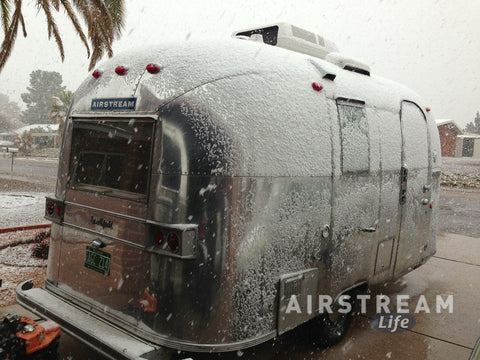 Caravel in snowy driveway