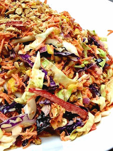 Tropical slaw of Napa cabbage, mango, sweet bell pepper and ground peanuts in a maple sesame lime dressing (GF)