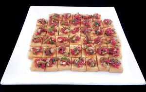 Chickpea polenta squares with toasted Marcona almonds and a salsa of Castelvetrano olives, piquillo peppers, shallots, parsley and sherry wine vinegar (GF, Vegan)