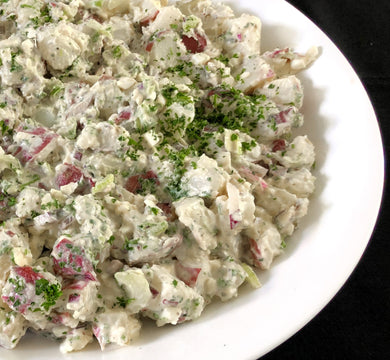Classic picnic potato salad with red bliss potatoes, hard boiled egg, celery, red onion and sweet pickle (GF) *