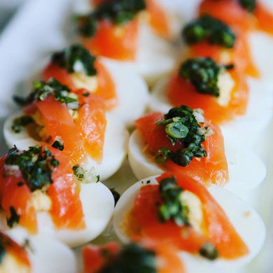 Deviled eggs with smoked salmon, creme fraiche and salsa verde