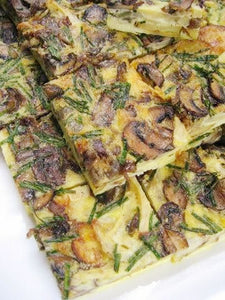 Frittata with artichoke hearts, crimini mushrooms, caramelized onions, potatoes, aged cheddar and fresh chives (GF)