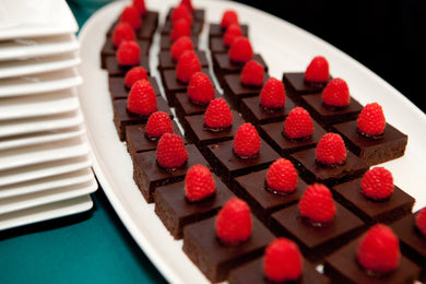 Miniature flourless chocolate cakes with raspberries (GF)