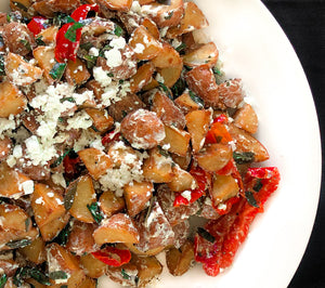Roasted new potatoes tossed with sweet peppers, goat cheese, basil and a balsamic dressing (GF)