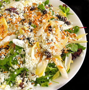 Salad of baby greens and endive with toasted almonds, sun-dried cranberries and fresh goat cheese with a balsamic tarragon vinaigrette (GF) *