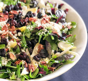 Salad of baby greens and endive with blue cheese, pecans and sun-dried cranberries in a red wine shallot vinaigrette