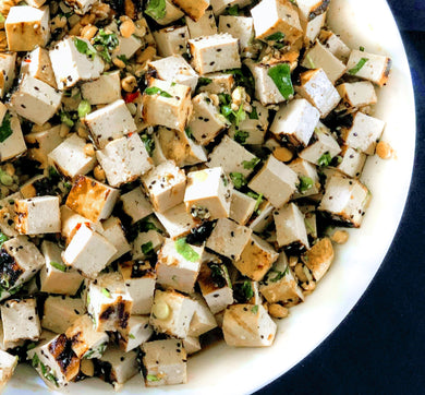 Grilled tofu salad with toasted peanuts, scallions and cilantro in a ginger honey soy vinaigrette (Vegan)