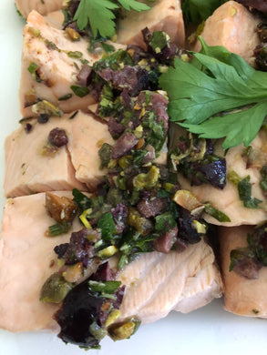 Poached salmon with a sauce of black olives, capers, pistachios, garlic, lemon, fresh herbs and extra virgin olive oil