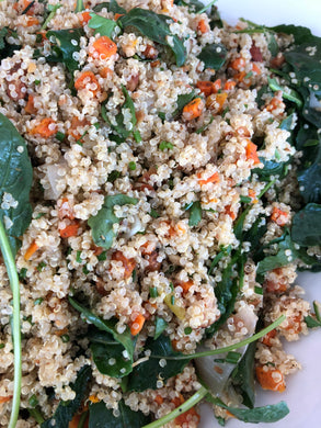 Quinoa salad with baby kale, leeks, carrots, toasted almonds, corriander, fresh herbs and lime