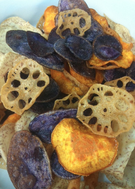 Homemade root vegetable chips with spicy yoghurt dip