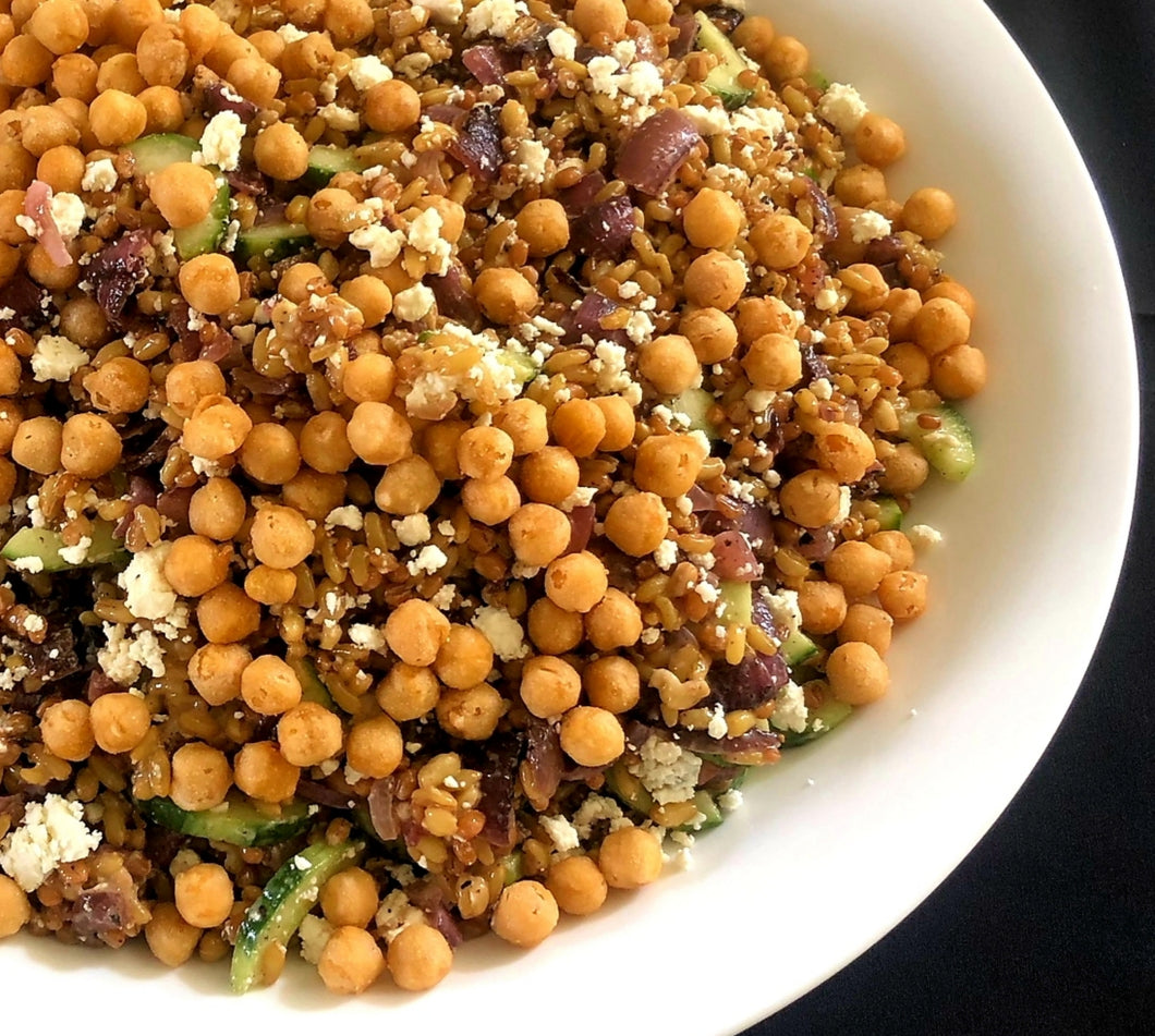Salad of kamut with English cucumber, grilled red onion, feta cheese and fried chickpeas in a date vinaigrette
