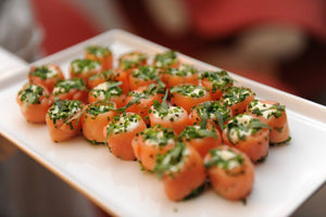 Smoked salmon wrapped around fresh goat cheese with chives and tarragon