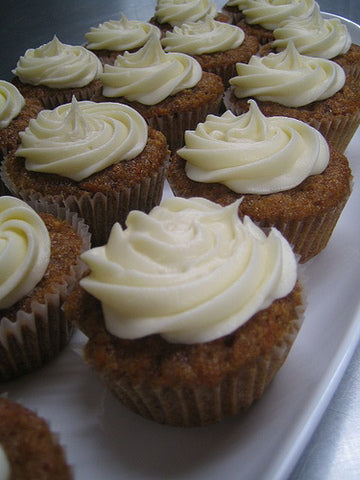 Carrot cake cupcakes with walnuts and cream cheese frosting