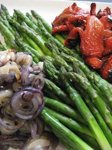Fresh asparagus, roasted sweet bell peppers and red onions in a black olive lemon vinaigrette
