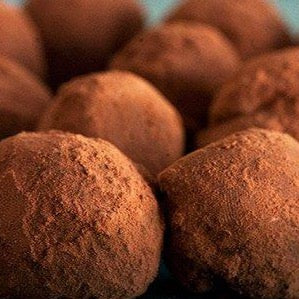 Homemade chocolate truffles with ancho chili, cinnamon and sea salt (GF) *