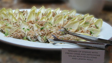 Spears of endive with fresh crab and artichoke salad with scallions and lemon aioli