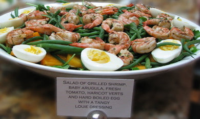 Salad of grilled shrimp, baby arugula, fresh tomato, haricot verts and hard boiled egg with a tangy louie dressing