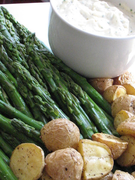 Chilled asparagus and purple and red bliss potatoes with a truffled parmesan garlic black pepper aioli