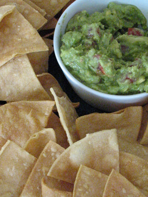 Fresh Mexican guacamole with homemade tortilla chips (Vegan)