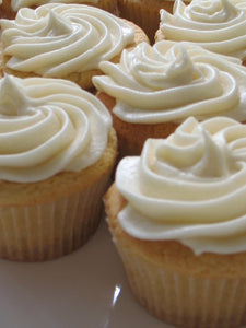 Tiny sour cream cupcakes with vanilla frosting