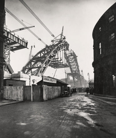 The Building of the Tyne Bridge - The road platform reaches out under the arch.