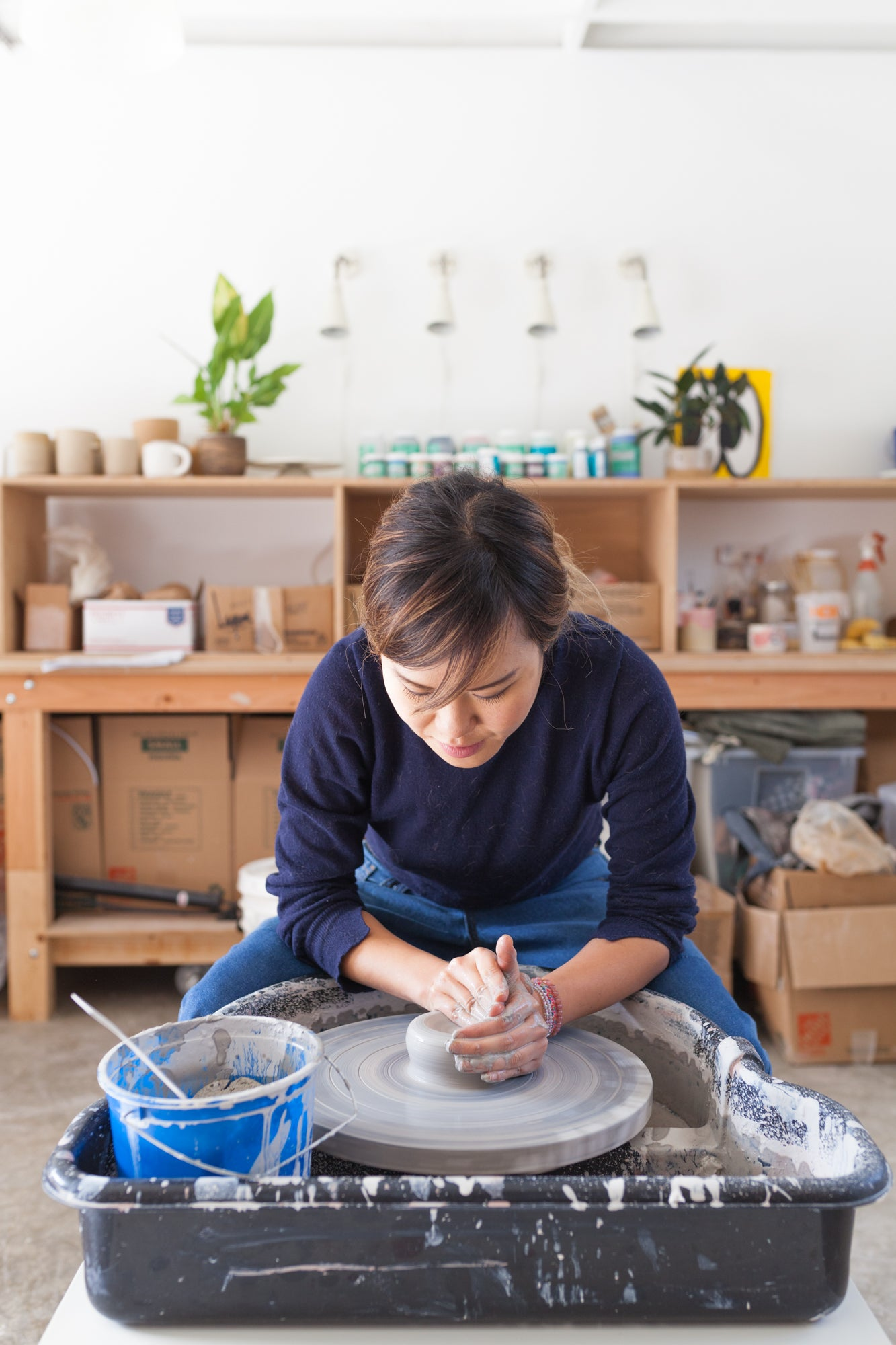 Carrie Lau using pottery wheel