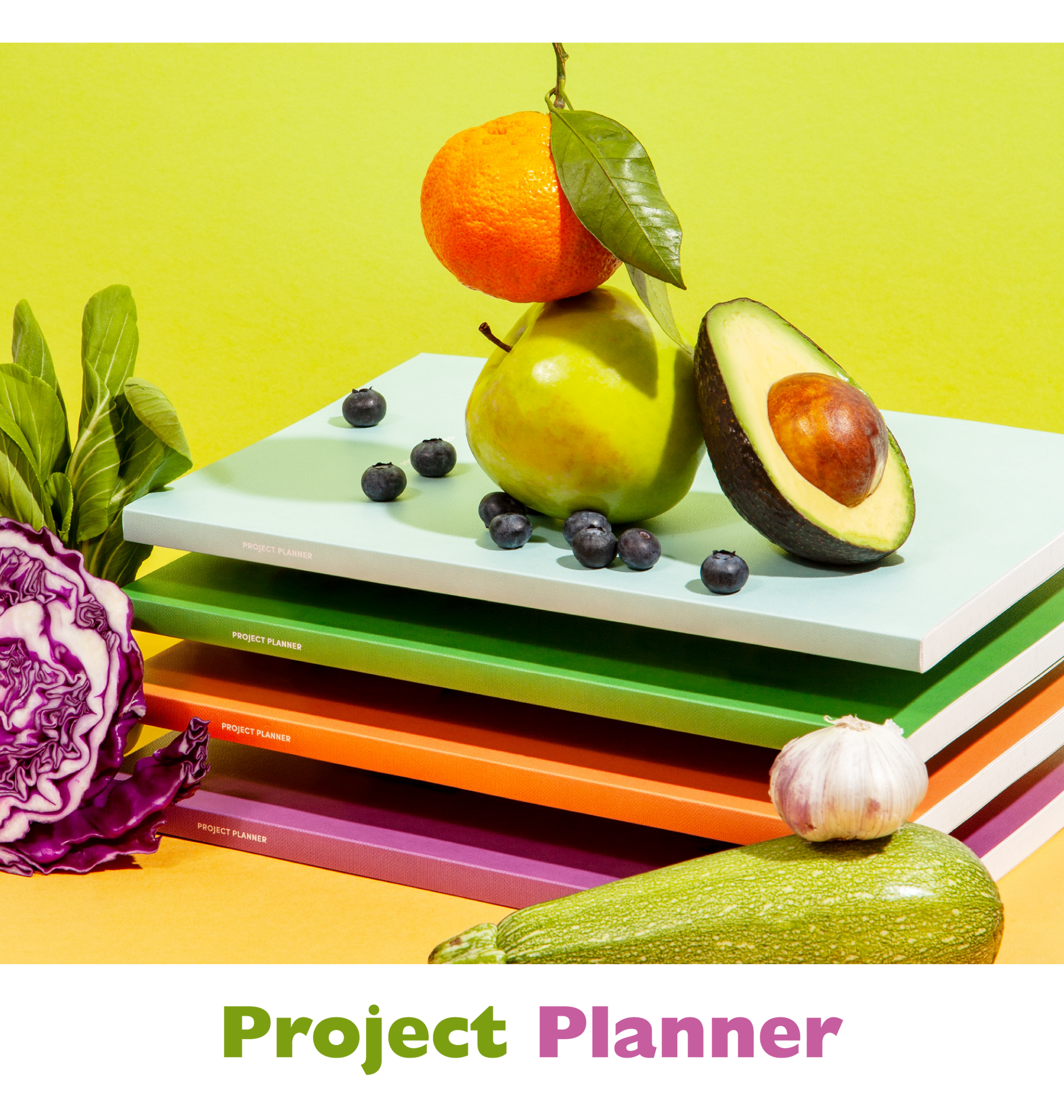 Planners stacked with fruit