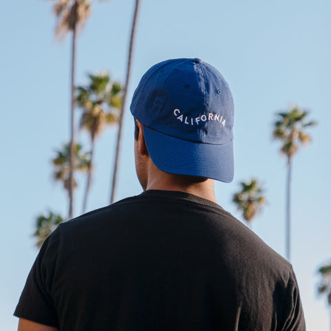 Model wearing California Cap in Yellow Blue