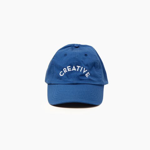 Creative Cap in Blue Front of Cap