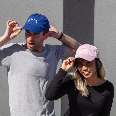 Model wearing Creative cap in Pink and Blue