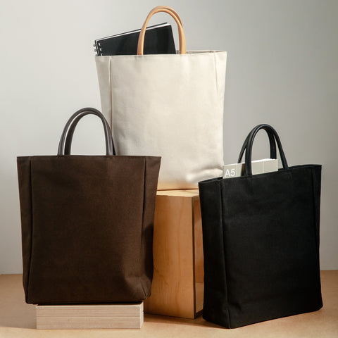 Essential Tote Group Shot Ecru Black Brown