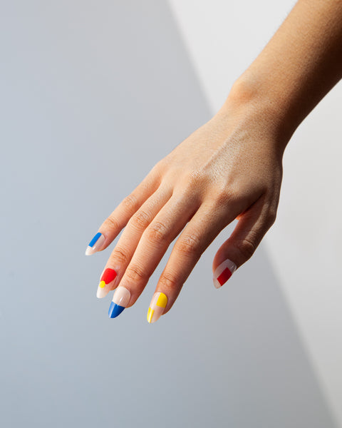Poketo Nail Polish Ellsworth Red Blue Yellow On Hand Model